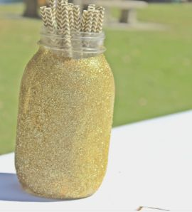 I am a jar hoarder, so I always have mason jars on hand. I glitter-bombed this one, and used it as a straw holder. Gold paper straws were found on Amazon.