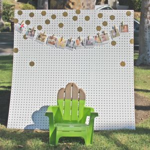 I made this photo-booth backdrop. It was super easy. I got the white peg board from Lowes, where they cut it for me, (this is 1/2 of the sheet). It cost about $15. I had the gold dot decals on hand, and the mini Polaroid pictures are from Paper Culture, (via Groupon).