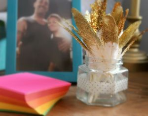 I couldn't part with these sparkly, glittery feathers, so I put them in an old honey jar (which was a favor from a friend's wedding), and put them on my desk so I could enjoy them every day.